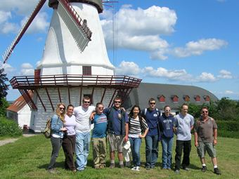 EICC students in Denmark standing in front of a windmill