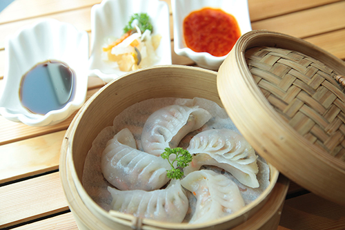 Chinese dumplings in a steam tray