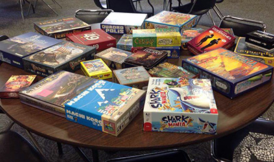 Pile of random board games on a table