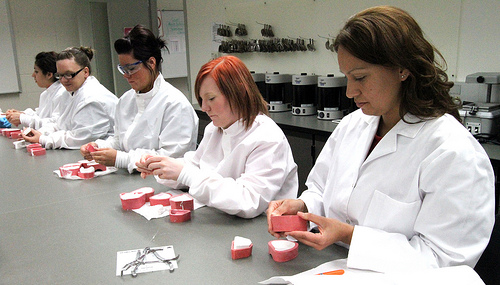 Dental students making dental molds.