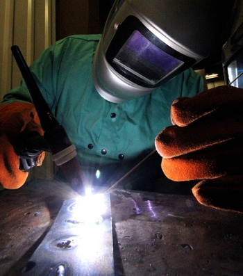 Student practicing welding in a lab